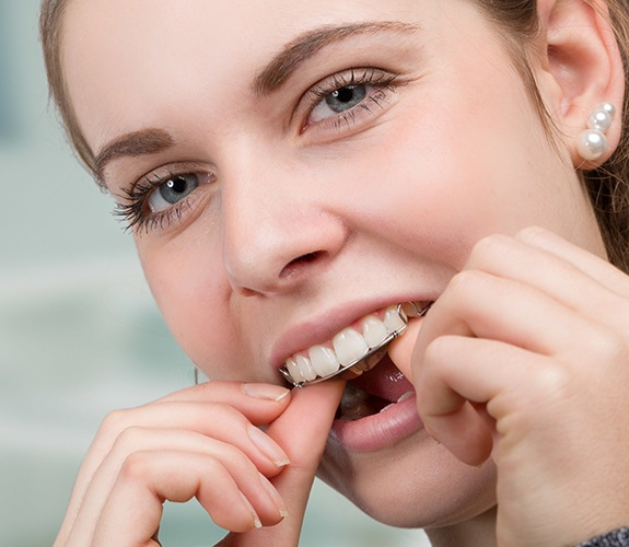 Woman placing her orthodontic appliance